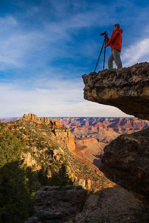 A photographer takes in the scenery of Grand Canyon National Park.