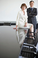 Two business colleagues at conference table portrait
