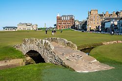 View of 18th hole fairway of  The Royal and Ancient Golf Club (R&A) and famous old Swilken Bridge over Swilken Burn on 18th Hole atOld Course in St Andrews, Fife, Scotland, UK.
