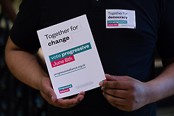 © Licensed to London News Pictures. 15/05/2017. LONDON, UK. A Progressive Alliance supporter holds a leaflet at the Progressive Alliance launch in London. The Progressive Alliance is a cross political party group who are campaigning against the Tories and encouraging tactical voting in the general election.  Photo credit: Vickie Flores/LNP