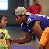 Ethan George, 17, right, talks to his little brother Connor Parker, 8, during the Miyamura High School Football Kiddie Camp Thursday, August 1 in Gallup.