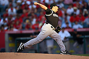 ANAHEIM, CA - JUNE 24:  Starting pitcher Jason Marquis #21 of the Colorado Rockies throws a pitch in the late day sun during the game against the Los Angeles Angels of Anaheim at Angel Stadium on Wednesday, June 24, 2009 in Anaheim, California.  The Angels defeated the Rockies 11-3.  ©Paul Anthony Spinelli*** Local Caption *** Jason Marquis