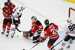 Mar 17, 2009; Newark, NJ, USA; New Jersey Devils goalie Martin Brodeur (30) makes a save while Chicago Blackhawks center Dave Bolland (36) looks for the rebound during the first period at the Prudential Center.