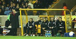 WOLVERHAMPTON, ENGLAND - Wednesday, January 21st, 2004: Liverpool's manager Gerard Houllier and his staff watch the Reds draw 1-1 with Wolverhampton Wanderers during the Premiership match at Molineux. (Pic by David Rawcliffe/Propaganda)