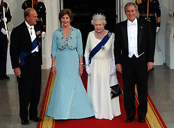 Britain's Queen Elizabeth II and the Duke of Edinburgh arrive for a state dinner hosted by the President of the USA, George Bush, right, and wife Barbara at the White House, Washington DC, on the sixth day of her state visit to the US.