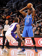 Jan. 14, 2013; Phoenix, AZ, USA; Oklahoma City Thunder forward Kevin Durant (35) handles the ball during the game against the Phoenix Suns forward Michael Beasley (0) in the first half at US Airways Center. The Thunder defeated the Suns 102-90. Mandatory Credit: Jennifer Stewart-USA TODAY Sports.