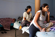 Jayshree Pillai (right), a surrogate for her first time, chats as other surrogates laze around in the surrogate's hostel in the compound of the Akanksha Infertility Center in Anand, Gujarat, India on 12th December 2012.  Photo by Suzanne Lee / Marie-Claire France