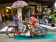 15 NOVEMBER 2016 - GEORGE TOWN, PENANG, MALAYSIA: A pedicab driver pushes his bike home before a thunderstorm in George Town, Penang. George Town is a UNESCO World Heritage city and wrestles with maintaining its traditional lifestyle and mass tourism.            PHOTO BY JACK KURTZ