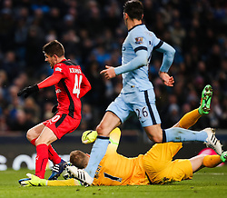 Andrej Kramaric of Leicester City is brought down by Manchester City's Joe Hart in the penalty area - Photo mandatory by-line: Matt McNulty/JMP - Mobile: 07966 386802 - 04/03/2015 - SPORT - football - Manchester - Etihad Stadium - Manchester City v Leicester City - Barclays Premier League