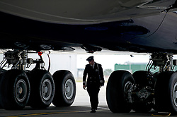 © London News Pictures.  04/07/2013 . London, UK.  A British Airways pilot walks beneath a new British Airways AIRBUS A380 superjumbo which arrived at Heathrow Airport. It was the first time British Airlines have taken delivery of the new plane, making British Airways the first European airline to operate both the 787 and A380. Photo credit : Ben Cawthra/LNP