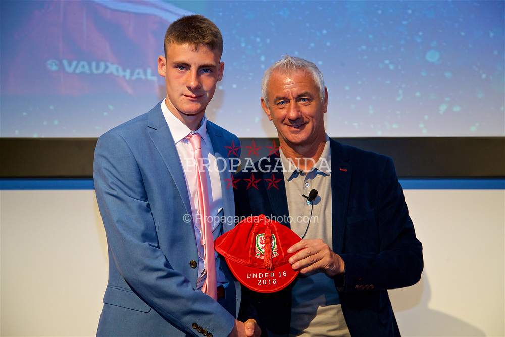 NEWPORT, WALES - Saturday, May 27, 2017: Jake Thomas receives his Under-16 Wales cap from Wales' Elite Performance Director Ian Rush at the Celtic Manor Resort. (Pic by David Rawcliffe/Propaganda)