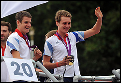 Edward and Jonathan Brownlee on the floats at The Olympic Parade at the Queen Victoria Memorial, London, Monday September 10, 2012 Photo Andrew Parsons/i-Images..All Rights Reserved ©Andrew Parsons/i-Images