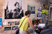 The walls of the small town of Arles are plastered with photographs for the Opening Week of Les Rencontres de la Photographie, Arles, July 6, 2016. © Carlo Cerchioli