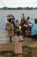 Ghana, Adaklu, Titikope, 2007. Cross-river taxis ply their trade all day, taking passengers between Titikope and other Volta River villages..