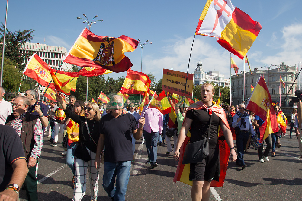 October 6, 2018 - Madrid, Spain - Protesters are seen walking holding flags while shouting during the protest..Millions of people with Spanish constitutional and Falangist flags demonstrated in Madrid against the Spanish government of Pedro Sanchez, for the unity of the country and against the inheritance tax. The demonstration stated at the Plaza de Colón to the Congress of Deputies. (Credit Image: © Lito Lizana/SOPA Images via ZUMA Wire)