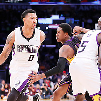 28 February 2014: Sacramento Kings shooting guard Orlando Johnson drives past Los Angeles Lakers shooting guard MarShon Brooks (2) on a screen set by Sacramento Kings small forward Quincy Acy (5) during the Los Angeles Lakers 126-122 victory over the Sacramento Kings at the Staples Center, Los Angeles, California, USA.