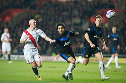 SOUTHAMPTON, ENGLAND - Saturday, January 29, 2011: Manchester United's Fabio and Johnny Evans cut out Southampton's Richard Chaplow during the FA Cup 4th Round match at St. Mary's Stadium. (Photo by Gareth Davies/Propaganda)