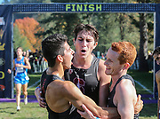 Oct. 27, 2017; Springfield, OR, USA; Stanford Cardinal runners Grant Fisher (L), Steven Fahy (C) and Alex Osterberg (R) celebrate after finishing 1-3-4 in the Pac-12 cross country championshipsat the Springfield  Golf Club. Stanford won the the men's championship.