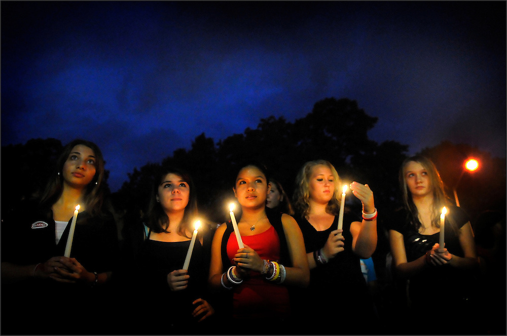 "Sayreville High School students hold up their respective candles during a candle light vigil held by Students Against Destructive Decisions (SADD) at Sayreville War Memorial High School on October 27, 2010.  The SADD Chapter at Sayreville High School held the event in remembrance of victims of alcohol and drug abuse. The event is also part of activities for ""Red Ribbon Week,"" which calls attention to the dangers of alcohol and drug abuse."