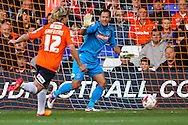 Mark Tyler of Luton Town (right) gestures to Scott Griffiths of Luton Town to lwave the ball during the Sky Bet League 2 match at Kenilworth Road, Luton<br /> Picture by David Horn/Focus Images Ltd +44 7545 970036<br /> 19/08/2014