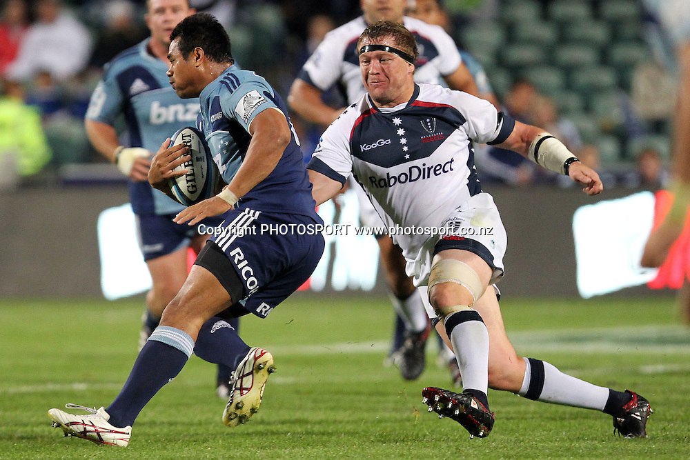 Rebels' Greg Somerville tries to keep up to Blues' Isaia Toeava. Super 15 rugby union match, Blues v Rebels at North Harbour Stadium, Albany, Auckland, New Zealand. Friday 22nd April 2011. Photo: Anthony Au-Yeung / photosport.co.nz