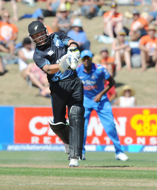 New Zealand's Brendon McCullum advances down the pitch to hit against  boundary against India in the first one day International cricket match, McLean Park, New Zealand, Sunday, January 19, 2014. Credit:SNPA / Ross Setford