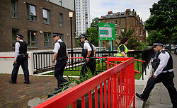 © Licensed to London News Pictures. 24/06/2017. London, UK. Police enter as residents are evacuated from Burnham block on the Chalcots Estate in Camden after it failed a fire inspection because of combustable cladding. More than 700 flats in tower blocks on an estate in the Swiss Cottage area of north-west London are being evacuated because of fire safety concerns. Photo credit: Ben Cawthra/LNP