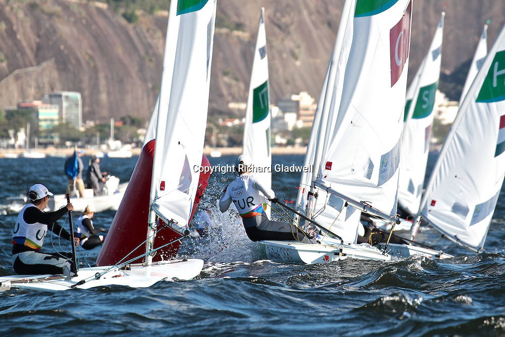 Laser Radials round gate mark in Race 10 - Day 6. Medal Race on Monday.<br /> Rio 2016 Olympics, Rio de Janero, Brazil. Olympic Sailing Day 6, 13 August 2016.<br /> Photo credit: Richard Gladwell / www.photosport.nz