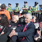 Supporters of Bradley Manning protest his imprisonment near Quantico Marine Corps base, March 20, 2011. More than two dozen people were arrested during the protest, including Daniel Ellsberg, a former military analyst (2nd from right). The arrests came at the end of a largely peaceful demonstration.