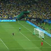Football - Olympics: Day 15  Matthias Lukas Ginter #4 of Germany scores from the penalty spot during the penalty shoot out beating Weverton #1 of Brazil during the Brazil Vs Germany Men's Football Gold Medal Match at Maracana on August 20, 2016 in Rio de Janeiro, Brazil. (Photo by Tim Clayton/Corbis via Getty Images)