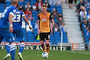 Hull City midfielder Sam Clucas looks for an opening during the Sky Bet Championship match between Brighton and Hove Albion and Hull City at the American Express Community Stadium, Brighton and Hove, England on 12 September 2015. Photo by Bennett Dean.