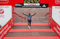 Eliud Kipchoge of Kenya crosses the line to win the Elite Mens race at the Virgin Money London Marathon, Sunday 26th April 2015.<br /> <br /> Dillon Bryden for Virgin Money London Marathon<br /> <br /> For more information please contact Penny Dain at pennyd@london-marathon.co.uk
