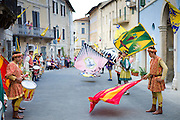 Contrada young man in livery costumes at traditional parade in Asciano, inTuscany, Italy