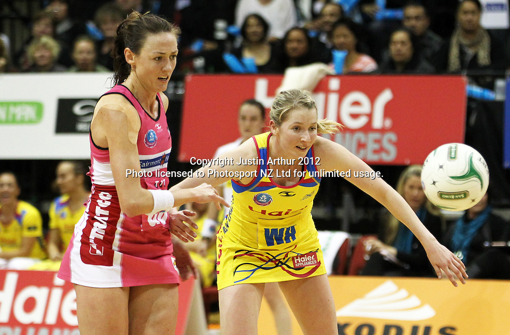 Pulse's Camilla Lees and Thunderbirds' Renae Hallinan compete for the ball during the ANZ Netball Championship, Haier Pulse v Adelaide Thunderbirds at TSB Bank Arena, Wellington, New Zealand on Monday 21 May 2012. Photo: Justin Arthur / photosport.co.nz