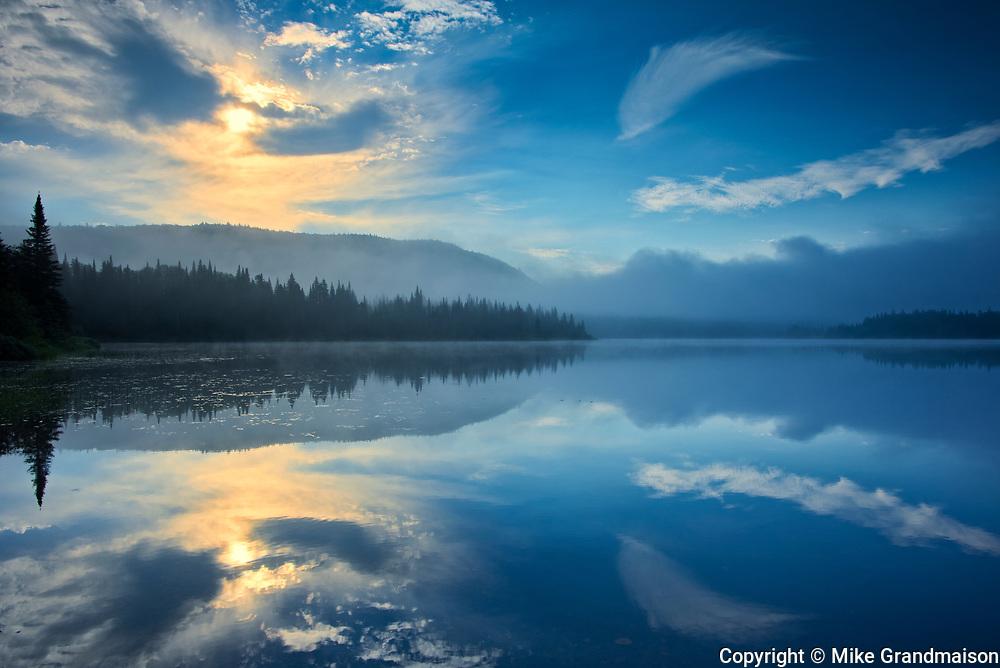 Reflection at sunrise on Lac La Joie<br />Parc National du Mont Tremblant <br />Quebec<br />Canada