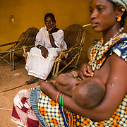 Haoua Bokoum Amadou (left), 14, her mother Fatoumata Diallo (center) and her grandmother Aissatou Hawa in the village of Pétéguersé, 40 km north of Dori, Burkina Faso on Monday May 11, 2009. A few months ago, Haoua was forced to marry the son of her village's chief - who is also her cousin.