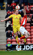 Dean Lewington wins a header during the Sky Bet League 1 match between Walsall and Milton Keynes Dons at the Banks's Stadium, Walsall, England on 14 March 2015. Photo by Alan Franklin.