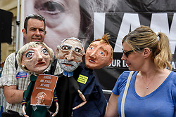 "© Licensed to London News Pictures. 02/06/2017. London, UK. A man carries papier mache puppets depicting Theresa May, Jeremy Corbyn and Tim Farron. Demonstrators gather outside the BBC headquarters in protest against the Corporation for not playing the song ""Liar Liar"" by Captain Ska on BBC Radio 1.  Organised by The People's Alliance, people carried signs bearing an image of Prime Minister Theresa May with the words ""Liar Liar"" and ""You Can't Trust Her"" on each side.   Photo credit : Stephen Chung/LNP"