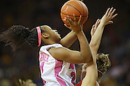 February 16 2011: Iowa Hawkeyes guard Kachine Alexander (21) puts up a shot over Wisconsin Badgers guard Alyssa Karel (30) during the first half of an NCAA women's college basketball game at Carver-Hawkeye Arena in Iowa City, Iowa on February 16, 2011. Iowa defeated Wisconsin 59-44.