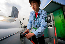 CHINA PUDONG DISTRICT SHANGHAI 23MAY10 - Wenen Li demonstrates the recharging procedure of an electric vehicle by SAIC Motors at the Expo 2010 in Shanghai, China...jre/Photo by Jiri Rezac / The Climate Group..© Jiri Rezac 2010