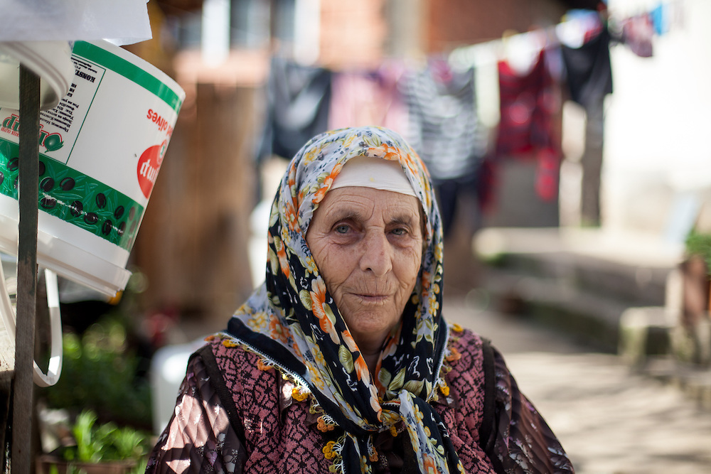 Portrait of an elderly woman at the Roma part in the city of Crnik.