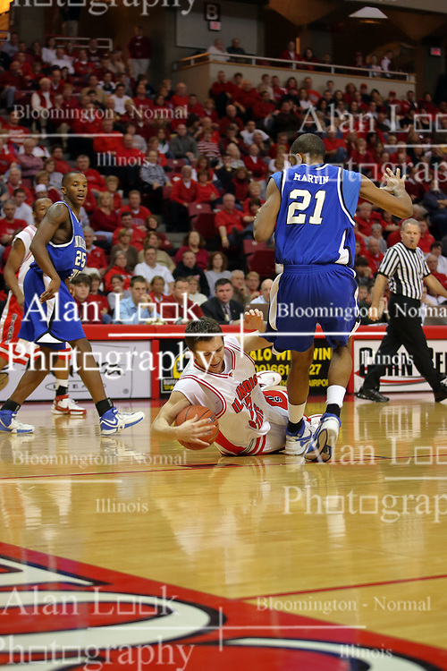 27 January 2008: Sead Odzic goes to the planks to save a bounding ball in a game where the Indiana State Sycamores were cut down by the Illinois State Redbirds 65-62 on Doug Collins Court at Redbird Arena in Normal Illinois..
