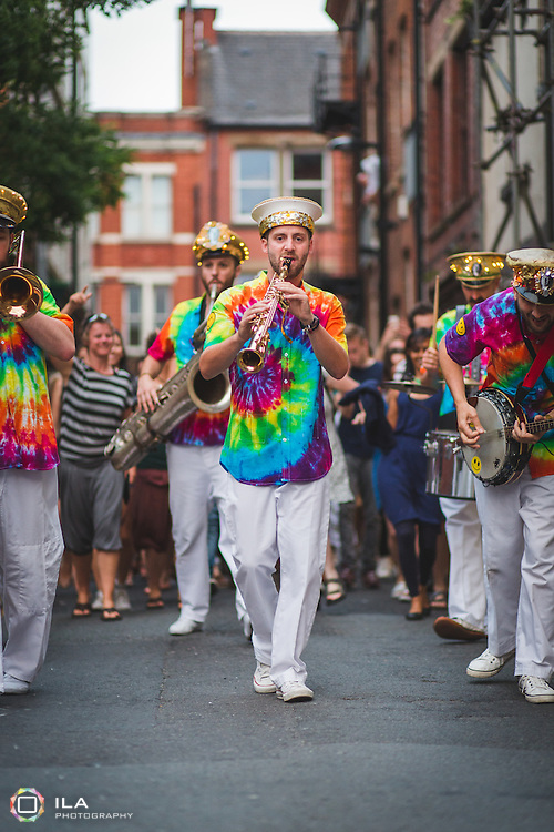 Mr. Wilson's Second Liners performing in the streets of Northern Quarter, Manchester, during the 2014 jazz festival.