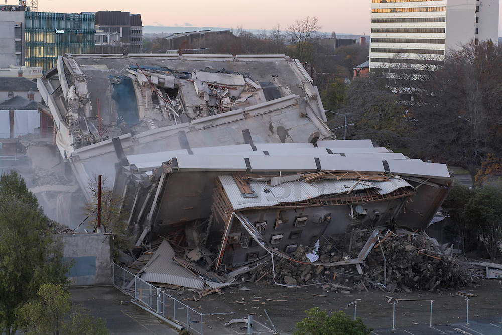 The old Central Police station, damaged in the Christchurch Earthquakes, is demolished by implosion,  Christchurch, New Zealand, Sunday, May 31, 2015. Credit:SNPA / David Alexander.