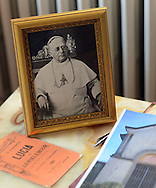 A portrait of Pope Pius XI is on display at the home of distant relative Daniela DeLuca, Tuesday September 22, 2015 in New Hope, Pennsylvania. She will be watching the papal mass by Pope Francis on the Parkway Sunday. (Photo By William Thomas Cain)