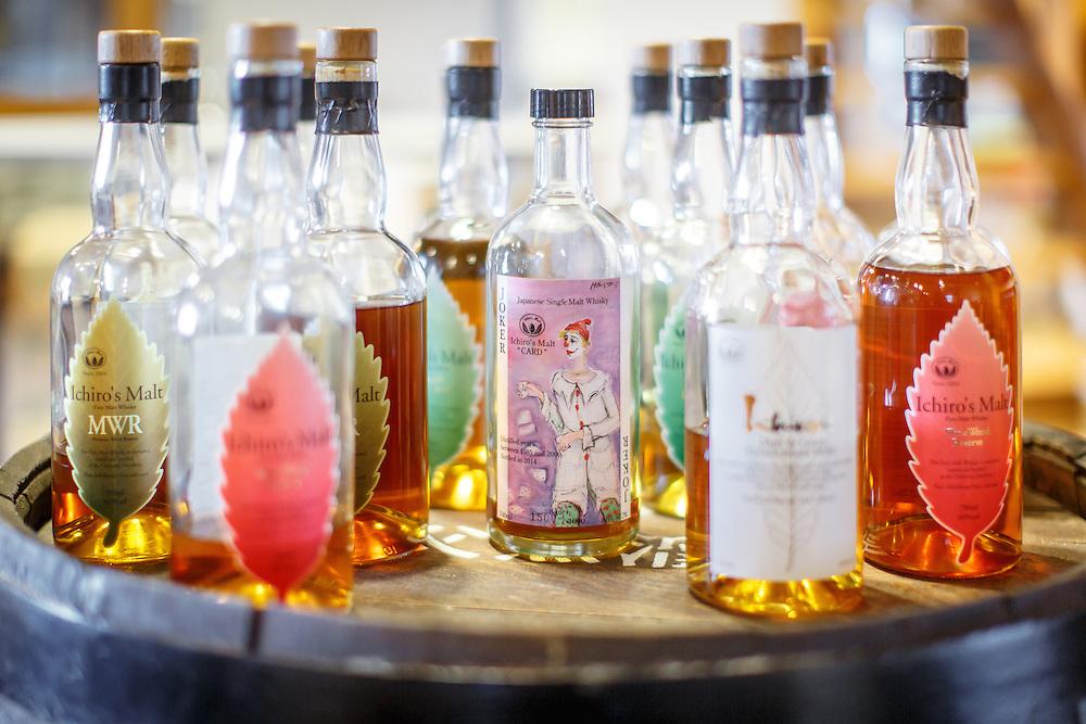 "Bottles of Ichiro's Malt whisky including the ""Card Series"" Joker sit on a barrel at Chichibu Distillery in Chichibu, Saitama Prefecture, Japan, November 4, 2015. Gary He/DRAMBOX MEDIA LIBRARY"
