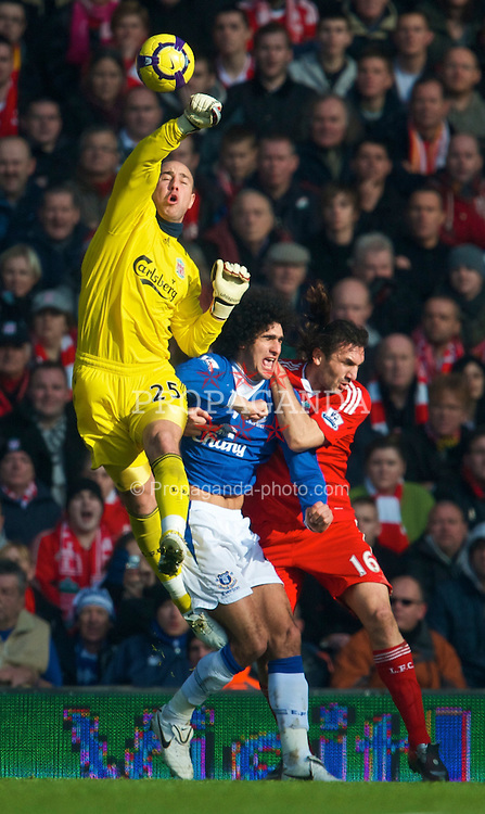 LIVERPOOL, ENGLAND - Saturday, February 6, 2010: Liverpool's goalkeeper Pepe Reina and Everton's Marouane Fellaini during the Premiership match at Anfield. The 213th Merseyside Derby. (Photo by: David Rawcliffe/Propaganda)