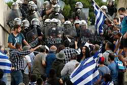 June 16, 2018 - Athens, Greece - Protesters clash with police during a protest against the agreement between Greece and Macedonia over the dispute of the former Yugoslav's republic name, outside the Greek Parliament, in Athens. Greek lawmakers on Saturday debated for a final day on a no-confidence motion against the government over a deal to end a decades-old dispute with neighboring Macedonia over the latter's name. (Credit Image: © Aristidis Vafeiadakis via ZUMA Wire)