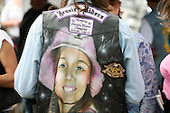 "Mark Lunsford wears an image of his daughter on his riding vest at the 3rd Jessie's Ride in Crystal River, Florida.  Lunsford's daughter, nine-year-old Jessica, was kidnapped and murdered by a registered sex offender.  She was reported missing exactly two years ago on Feb. 24, 2005.  Lunsford has spent the past two years raising awareness and working to pass ""Jessica's Act"" strengthening penalties against child predators.  To date, the act has passed in 26 states."
