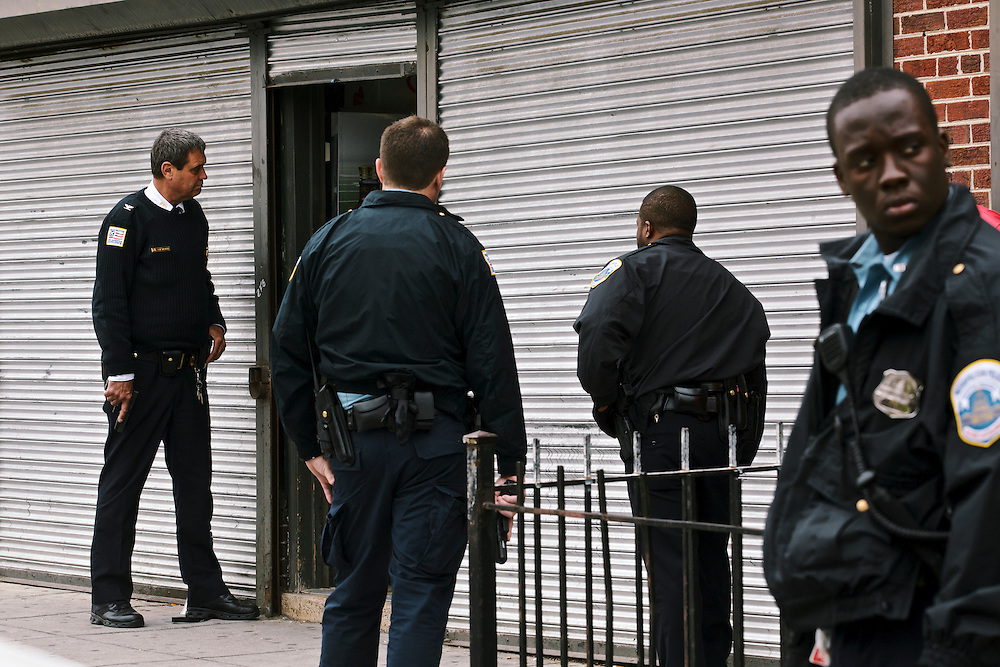 DC police commander Andy Solberg responds to a call of an attempted armed robbery at a liquor store. The store owner said the armed robber was still inside in a storage room.